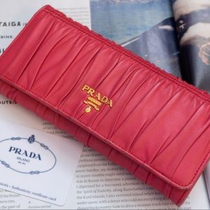 PRADA Guafre Nappa Leather Wallet in Pink.
